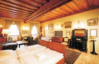 2 person deluxe suite with private facilities (bath and shower), and breakfast