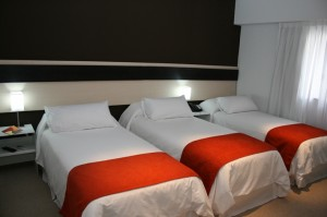 Standard triple with city view, king bed, private facilities (bath and shower), and breakfast