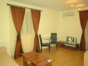 3 person superior 2 room apartment with city view, queen bed, and private facilities (bath and shower)