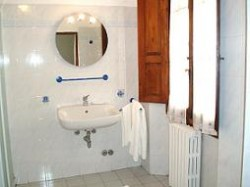 Standard single with french bed, and private shower shared toilet