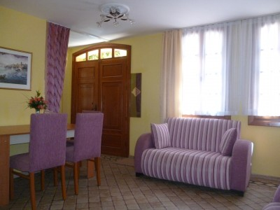 3 person standard 2 room apartment with city view, french bed, and private facilities (bath and shower)