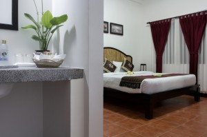 Deluxe triple with pool view, balcony, and private shower shared toilet