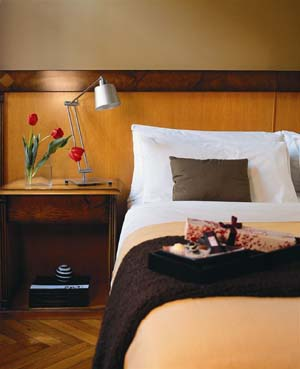 2 person junior suite with city view, queen bed, private facilities (bath and shower), and breakfast