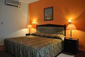 Single with queen bed, and private facilities (bath and shower)