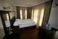 Comfort double with garden view, private facilities (shower), and breakfast