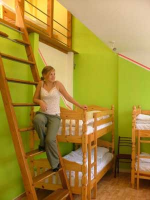Bed in a standard 8 person dormitory with garden view, and shared facilities