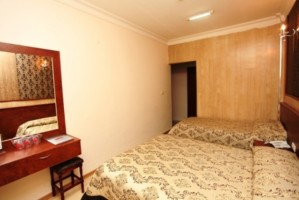 Standard 2 room twin with city view, private facilities (bath and shower), and breakfast