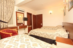 Standard triple with city view, private facilities (bath and shower), and breakfast