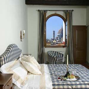 4 person superior suite and 2 children with city view, king bed, private facilities, and breakfast