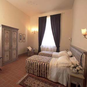 2 person standard suite and 2 children with city view, king bed, private facilities, and breakfast