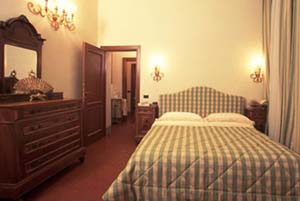4 person standard suite and 2 children with city view, king bed, private facilities, and breakfast