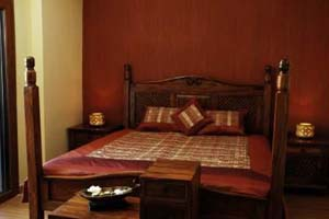 2 person executive suite with pool view, king bed, an extra bed, private facilities (bath and shower), and breakfast