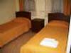 Classic 1 room double or twin with garden view, french bed, private shower shared toilet, and breakfast