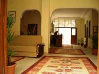 Family 1 room double with garden view, french bed, an extra bed, private shower shared toilet, and breakfast